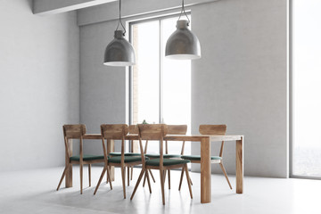 Wooden table with gray and wooden chairs, windows