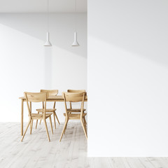 Wooden dining table in a white room, wall