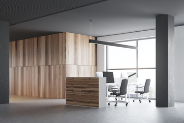 Gray and wooden office cubicles, side view