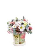 Bouquet in a pot of yellow, white chrysanthemums, chamomile, eucalyptus, lavender, cotton, eustoma, cloves. A holiday, a gift for a woman. Smart Side view Isolated