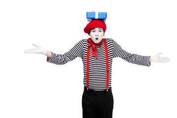 mime showing shrug gesture with gift box on head isolated on white