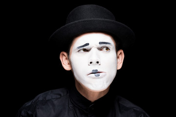 thoughtful mime with makeup isolated on black
