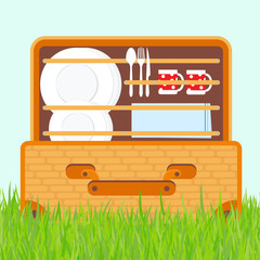 Open basket for a picnic with tableware and foods vector illustration