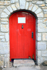 wooden retro red door with free note paper for texture