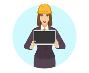 Businesswoman construction helmet showing blank digital tablet PC