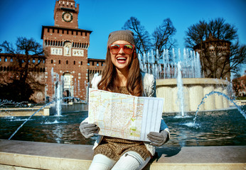 happy modern woman in Milan, Italy having excursion