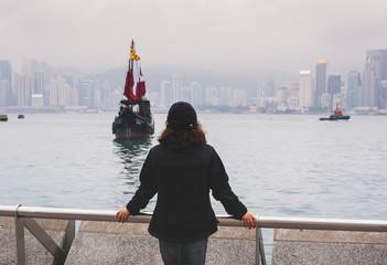 Traveler in Hong Kong Victoria Harbor