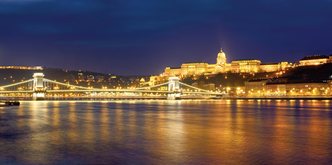Chain bridge and Royal Palace in Budapest , night panorama