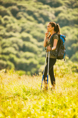 Young woman is hiking in mountain in summertime.