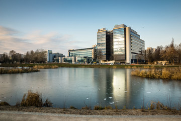 Pond Sluzewiecki and office building at winter in Mokotow district, Warsaw, Poland