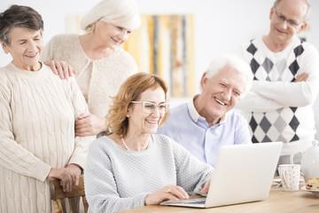 Elders smiling at laptop