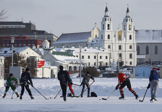 Youths play ice hockey on an outdoor rink in Minsk