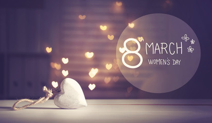 Happy Women's Day message with a white heart with heart shaped lights