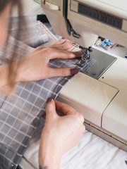 Girl working on sewing machine with textile napkins