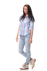 Picture of a young casual woman standing on white