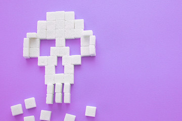 The skull made of sugar cubes. Sugar kills. serene background.