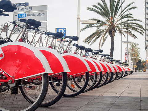 Group of red rental bicycles at the Barcelona street