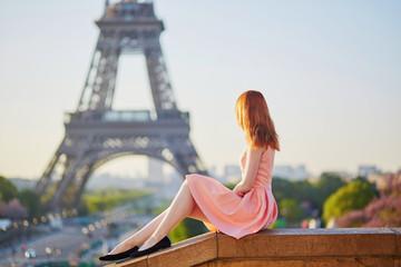 Girl in pink dress near the Eiffel tower, Paris