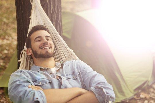 Relaxed man lying in a hammock