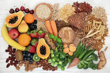 Food with high fibre content for a healthy diet with fruit, vegetables, whole wheat bread, pasta, nuts, legumes, grains and cereals. High in antioxidants, anthocyanins and omega 3 fatty acid.