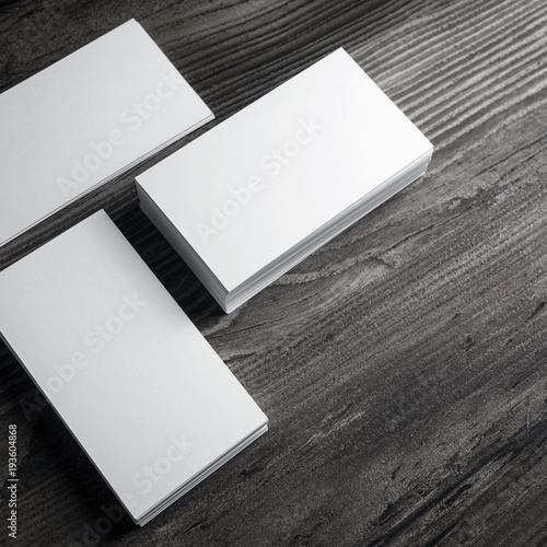 blank white business cards mockup on wood table background stock