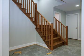 Hallway interior with hardwood floor. View of wooden stairs.