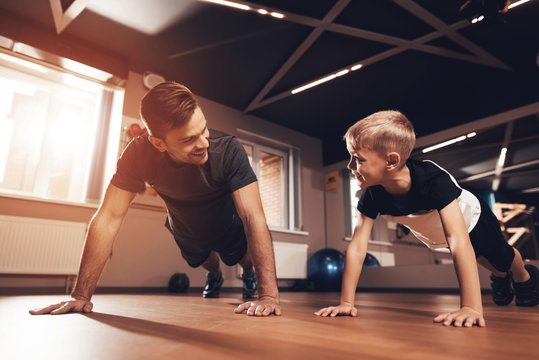Father and son in the gym. Father and son spend time together and lead a healthy lifestyle.