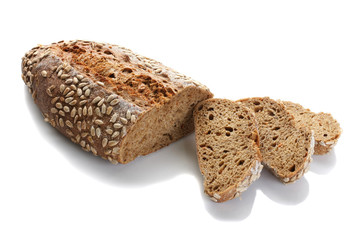 a loaf of unleavened bread with sunflower seeds close-up on a white background