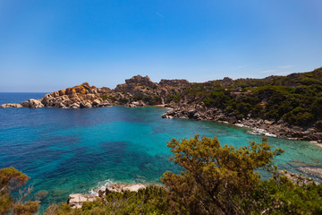 Beautiful mediterranean coastline with a blue cloudless sky, Sardinia, Italy
