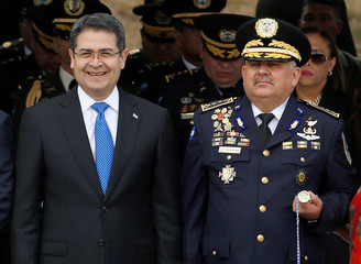 Honduras' President Hernandez and Chief of the National Police Aguilar Moran attend a promotion ceremony for members of the police in Tegucigalpa