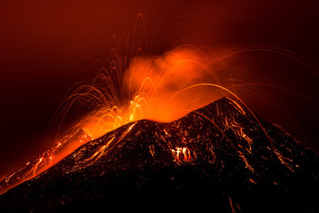 Volcano eruption landscape at night - Mount Etna in Sicily