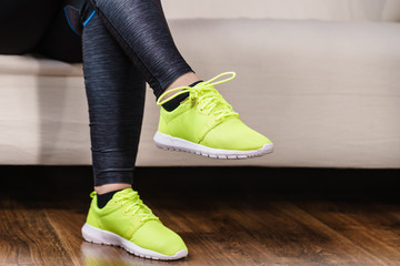 Woman putting sport shoes