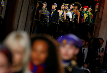 Models present creations from the Versace Autumn/Winter 2018 women collection during Milan Fashion Week in Milan