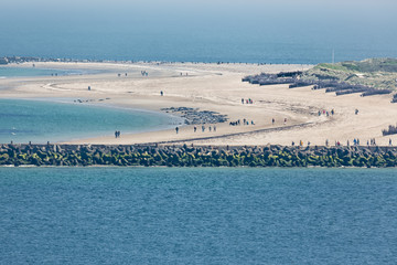 Aerial view German island Dune in the Northsea opposite of Helgoland. People are photographing seals resting at the beach