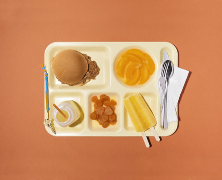 School Lunch:Sloppy Joe on a Bun with Canned Carrots Peaches Popsicle and Juice