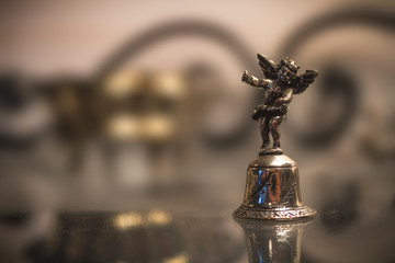 Silver Bell With Angel Macro