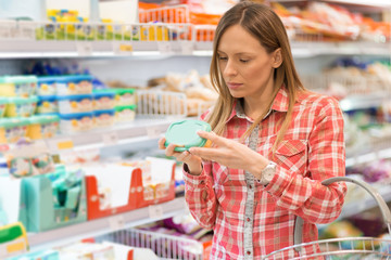 Woman buying dairy products.