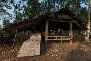 Traditional rural bamboo chair outside rice field bad weather hut Asia.