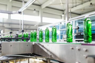 Bottling plant - Water bottling line for processing and bottling water into green glass bottles.