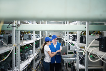 Man and woman on the farm for the extraction of crypto currencies. Bitcoin mining