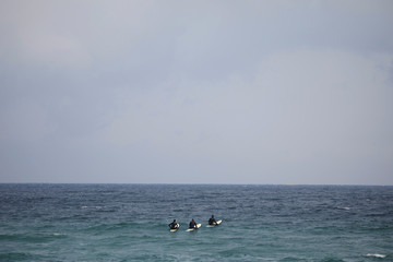Australian Olympic team members wait for a wave in Gangneung
