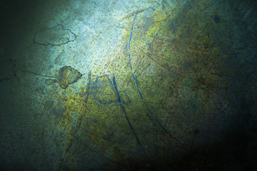 Dark abstract texture of the old surface in blue tones. Grim background with shabby.