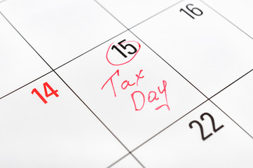Tax day written on the calendar and circled 15th day by marker. Tax pay Deadline concept.