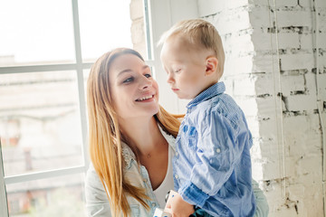 Happy Mother and her Little Son Portrait. Pretty  Mom and Child Boy Embracing and Having Fun