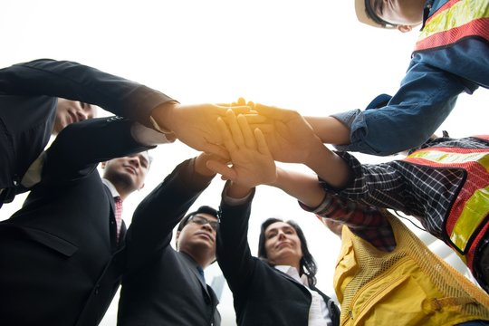 Hands put together to show unity and cooperation