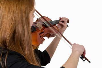 Girl with long hair playing a violin isolated on a white background