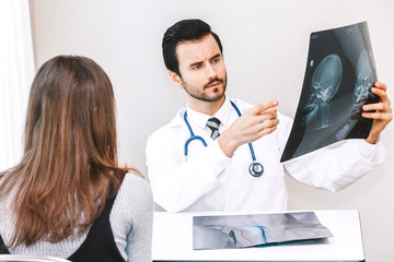 Doctor showing the X-ray photo to female patient in hospital.healthcare and medicine