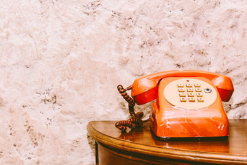 Vintage phone on wooden table background