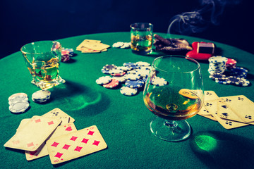 Cards and chips in vintage gambling green table