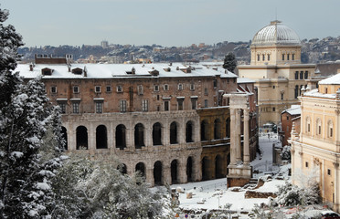 Unusual view of Theater of Marcellus ancient ruins covered by snow, in the historic center of Rome (1st century AD)